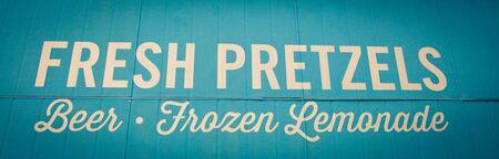 fresh pretzels and beer sign