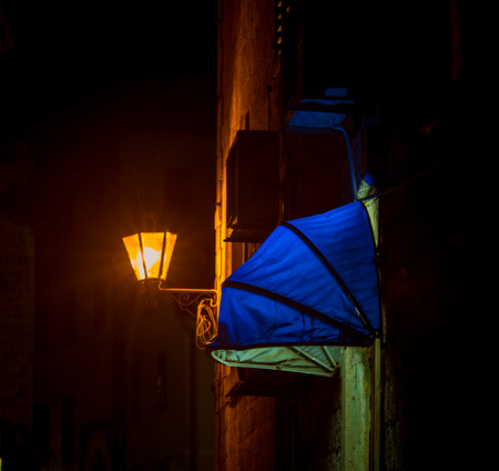 blue canopy above a door 스톡 콘텐츠