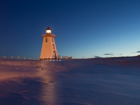 Lighthouse at night in winter