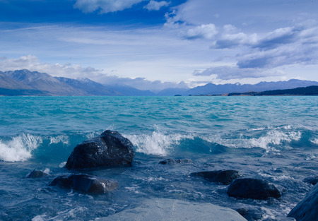 Rocks in lake tekapo Stock Photo