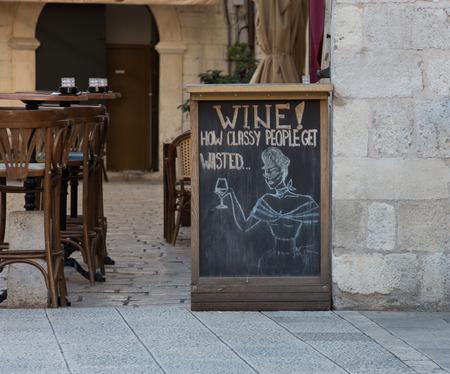 chalkboard advertising wine in Dubrovnik