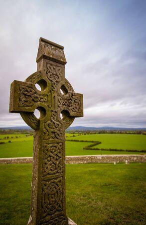 Celtic cross in a graveyard in Ireland