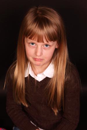 little girl sad pout face