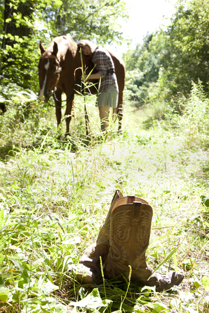 steed: Boots and cowgirl and horse Stock Photo