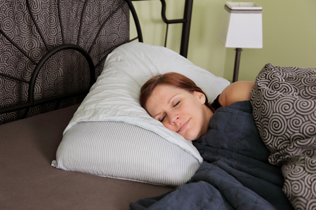 A young woman fell asleep in bed exhausted