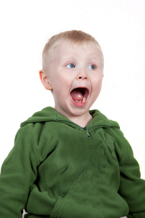 Wide eyed open mouthed smiling boy Stock Photo