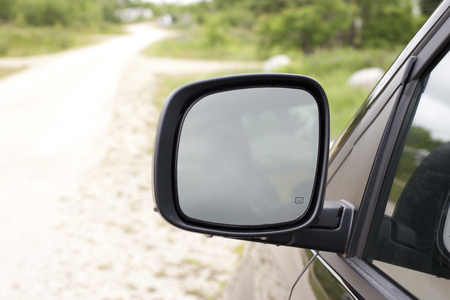 shiny car: a large square mirror on a black van, suv, or car with blank reflection Stock Photo