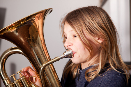 Profile of young girl playing baritone instrument