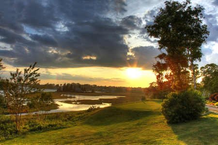 A beautiful river beside the tee-box at a Canadian Golf Course (Nova Scotia) at sunset. Stock Photo