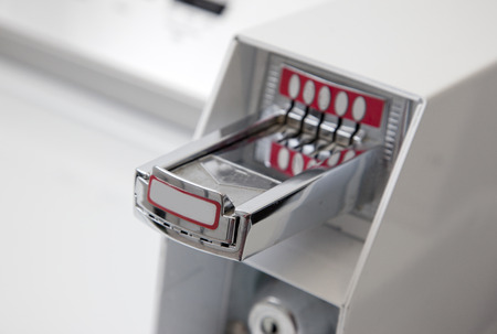 close up of coin slots for a washing machine or dryer 版權商用圖片