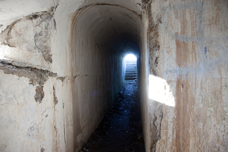 garrison: old abandoned cement hallway in an armoury or defense structure