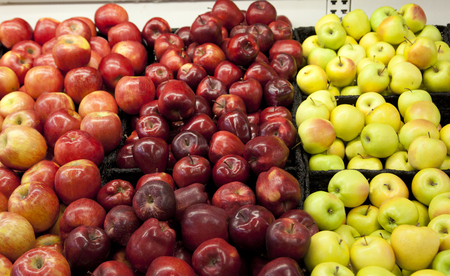 a variety of apple types and shapes at the supermarket Stock Photo