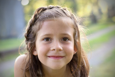 portrait of a beautiful brown eyed girl with braided hair Banco de Imagens