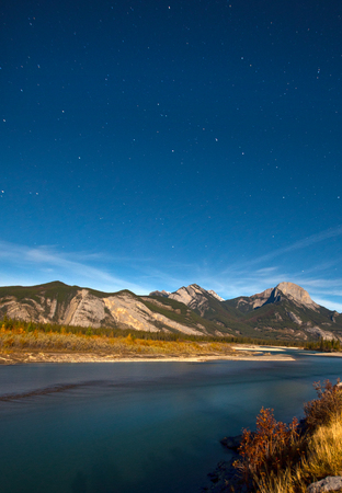 thoroughfare: stars and constellations above the rocky mountains Stock Photo