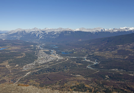view from the top of pyramid mountain looking down on the town of jasper in alberta