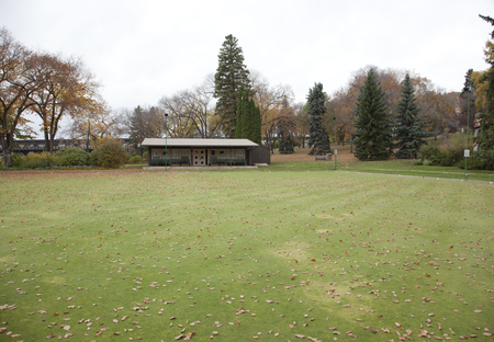a green lawn bowling area in the park