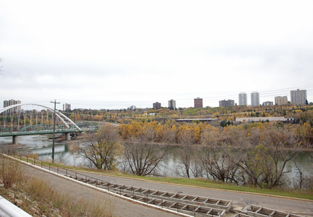 view of the edmonton skyline in fall with the walterdale bridge and north saskatchewan river  Stock Photo