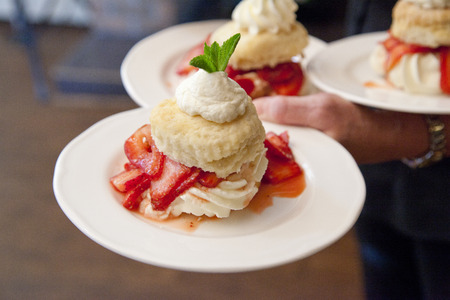 beautiful biscuits strawberries and cream on a dessert plate