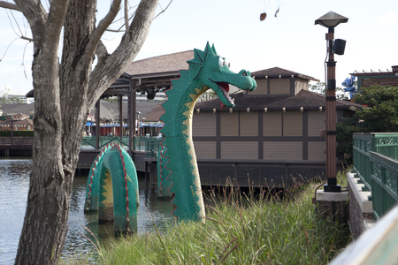 February 4, 2018 - Orlando, Florida: A green dragon made entirely out of lego at Disney Springs
