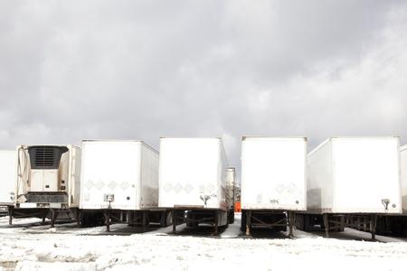 a row of eighteen wheeler truck beds