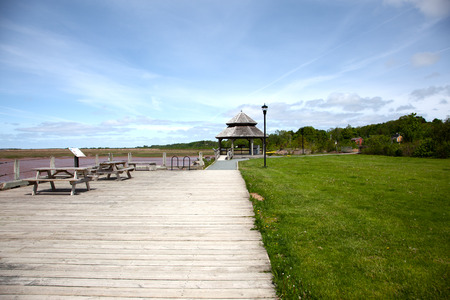 A brown gazebo by the waterfront in Wolfville, Nova Scotia