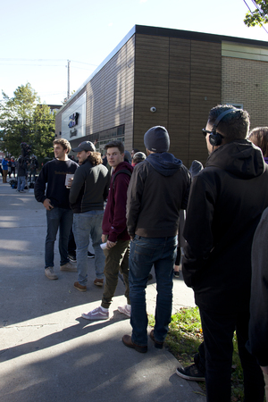October 17, 2018: Halifax, Nova Scotia: Smiling patrons wait in line outside the Clyde Street NSLC on the morning the cannabis becomes legal in Canada Editorial