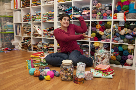 Woman shows off her amazing collection of swatches and fat quarters Stock Photo