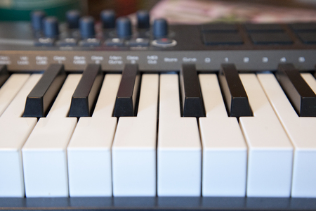 A piano keyboard with dials for creating sounds and music Stock Photo - 113086222