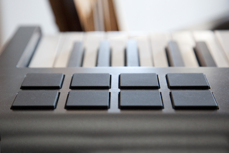 A digital piano keyboard with midi pads for creating sounds