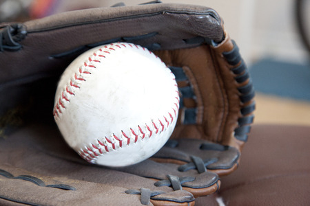 A softball and leather glove ready to play ball Stock Photo - 113086258