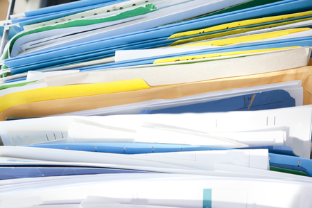 A messy drawer or cabinet with filed papers and documents sorted in folders Stock Photo - 113086259
