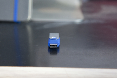 A blue memory stick or usb flash drive with copy space on a desk Stock Photo - 113086265