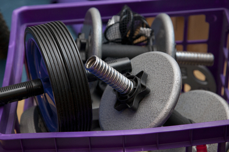 Metal workout weights in a milk crate box Stock Photo - 113086266
