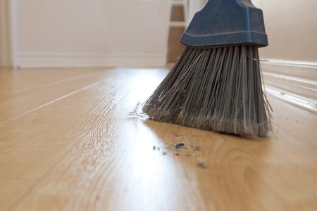 Broom sweepings with dust and dirt on the wood floor with copy space Stock Photo - 113086332