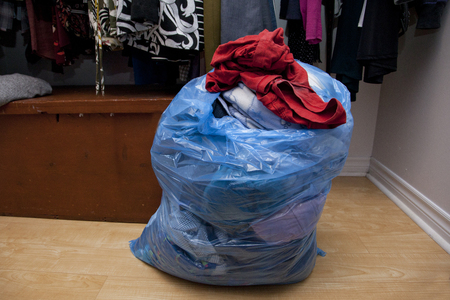 Someone has cleaned out their closet and made a bag of clothes to donate or purge Stock Photo - 113086345