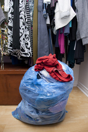 Bag of clothes taken out of a closet, ready to be donated or given away Stock Photo - 113086346