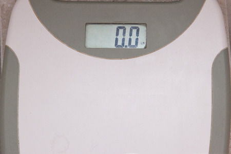 A bathroom scale showing the number 0 or no weight Stock Photo - 113086367
