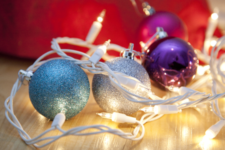 Purple, blue and silver round ornaments and lights