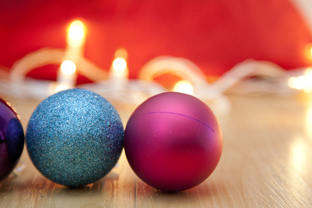 Pink and sparkly blue christmas ornaments with white lights Stock Photo - 113086392