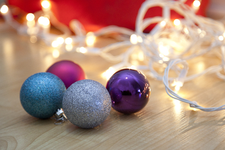Four colorful christmas lights with tangled white lights on the floor Stock Photo