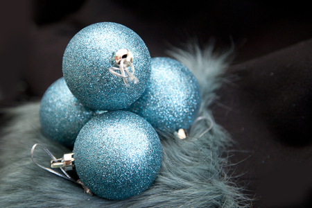 Holiday season can be difficult, scene set with blue round baubles and dark background Stock Photo - 113086409