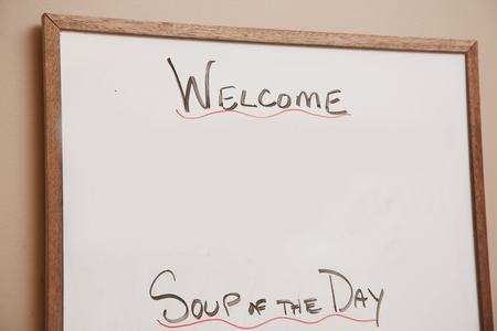 A whiteboard with Soup of the Day written on it and blank space for text or image Stok Fotoğraf