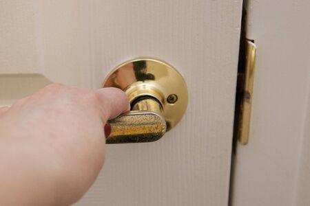 pulling the door closed Banco de Imagens