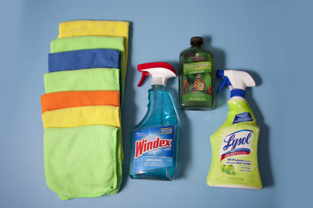 Halifax, Canada- June 1, 2019: Cleaning supplies and rags against a blue background