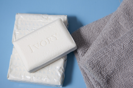 Halifax, Canada- June 1, 2019: Ivory brand soap with grey face cloths 報道画像