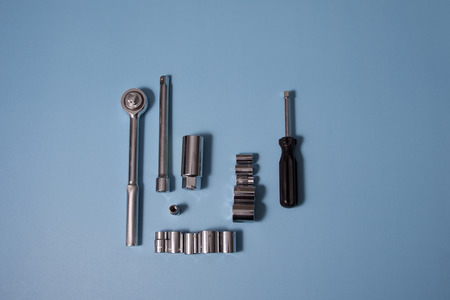 Metal ratchet and sockets against blue background with copy space 写真素材