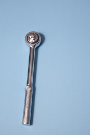 Single socket driver against a blue background