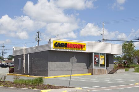 Sackville, Nova Scotia, Canada- June 15, 2019: The exterior of a Cash Money finance lender 에디토리얼