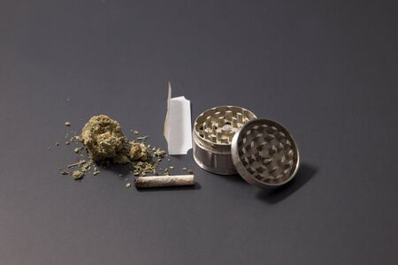 partially smoked doobie with marijiana, grinder, and a few grams of weed