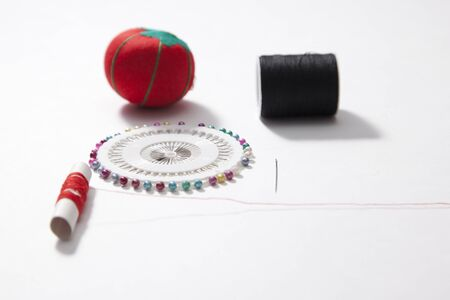 Sewing equipment with pin cushion and needle and thread